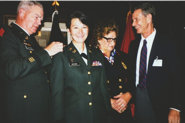 Army Reserve Brig. Gen. Coral Pietsch is all smiles as her stars are pinned on at her 2001 promotion ceremony.  Not only was she the first Asian-Pacific American woman general in the Army Reserve but she was the first in the entire Army.   She was also the first woman general in the Army's Judge Advocate General Corps.