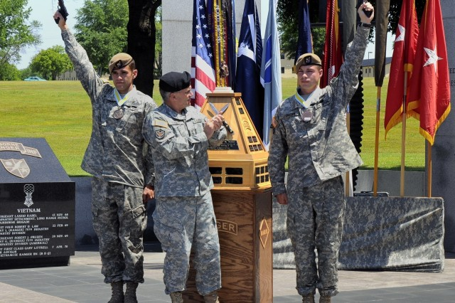 FORT BENNING, Ga. (Army News Service, April 22, 2008) -- Gen. George W. Casey Jr. applauds Staff Sgts. Michael Broussard (left) and Shayne Cherry for capturing the top spot in the 2008 David E. Grange Jr. Best Ranger Competition held April 18-20 at Fort Benning, Ga. Broussard and Cherry, who  represented the 75th Ranger Regiment, competed with other Soldier-Ranger-athlete teams in 22 around-the-clock Ranger Olympic events that tested to the extreme their physical, mental and technical abilities as Rangers.