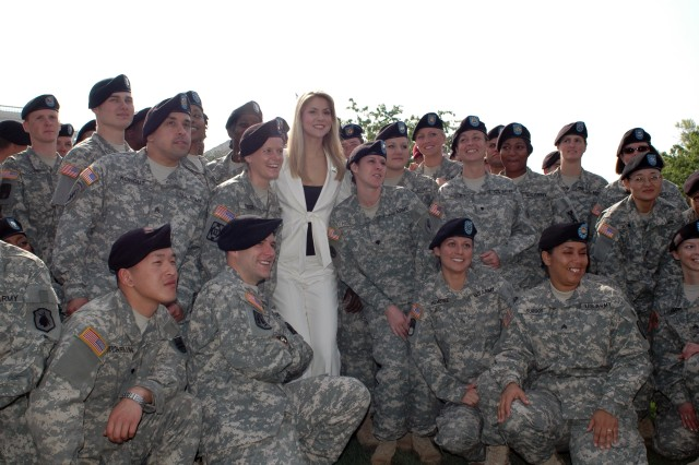 Miss America Kristen Haglund,poses with Army Reserve Soldiers after their re-enlistment ceremony April 23, on the west lawn of the Capitol Building.