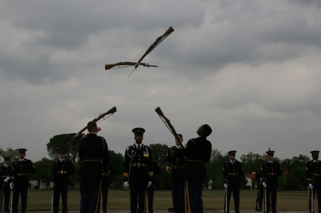 "Soldiers from the elite U.S. Army Drill Team, from Andrews Air Force Base, Md., toss their bayonet-tipped 1903 Springfield rifles into the air during one of their breathtaking routines. When not performing for the president or visiting dignitaries and heads of state, the Drill Team travels extensively, acting as ""good-will ambassadors"" for the Army and participating in major military and civic functions."