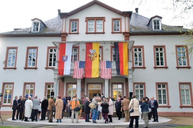 German and American guests mingle at Olof-Palme Haus in Hanau, Germany, during an official farewell ceremony for U.S. forces April 17.