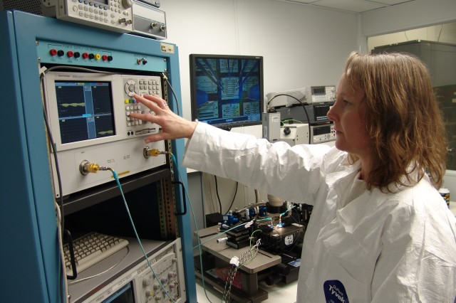 Janice Rock, an electronics engineer in Radio Frequency Technology Division, Applied Sensors, Guidance and Electronics Directorate, observes and makes adjustments on some of the millimeter wave testing and evaluation equipment within her laboratory.