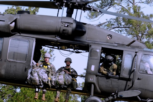 Staff Sgt. Mitchell Tisserand (left) and teammate Capt. Brian Braithwaight of team 20, representing the 5th Ranger Training Battalion, head for the drop zone on day one of the 2008 Best Ranger Competition April 18 at Fort Benning, Ga.