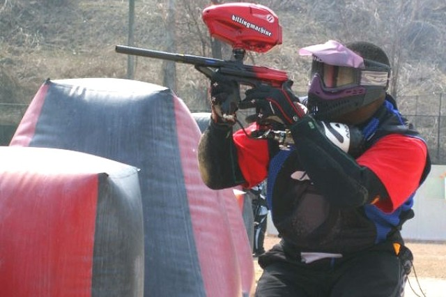 A competitor at the annual paintball tournament takes aim at his opponents April 6 at the U.S. Army Garrison Casey, South Korea,  paintball field.