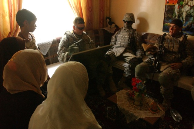 1st Lt. Brady Cowan, a platoon leader assigned to U.S. Army Europe's Company F, 2nd Squadron, 2nd Stryker Cavalry Regiment, sits down at an Iraqi family's request to talk about whether they have concerns about security in Saha, a Shi'a and Sunni-mixed community in the Rashid district of southern Baghdad, Iraq.