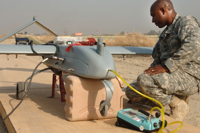 Staff Sgt. Alton Jefferson, from Company B, 173rd Special Troops Battalion, prepares a Shadow unmanned aerial vehicle for a reconnaissance flight over Jalalabad, Afghanistan.
