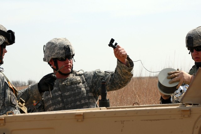 Staff Sgt. Robert Fortney and his team from the 774th EOD Company from Fort Riley, Kan. prepare a charge to destroy unexploded ordnance on a training lane during the 84th Ord Bn EOD Team of Year Competition at Smokey Hill Weapons Range, Kan. on April 16, 2008.