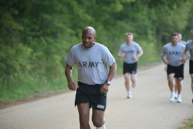 Col. Kendal Cunningham completes the first of four laps during the two-mile run.