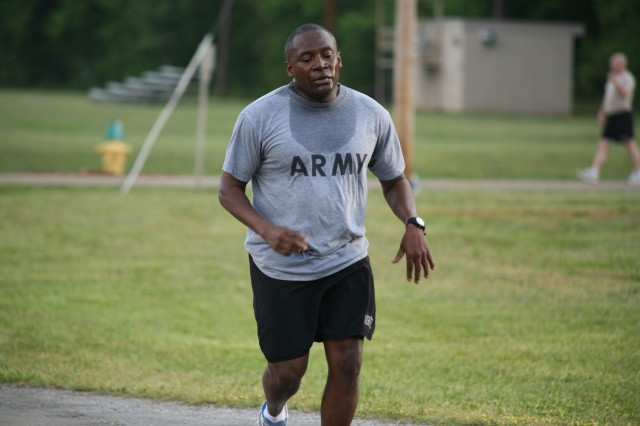 Sgt. Maj. Randall Williams completes the first mile during the running portion of the PT test.