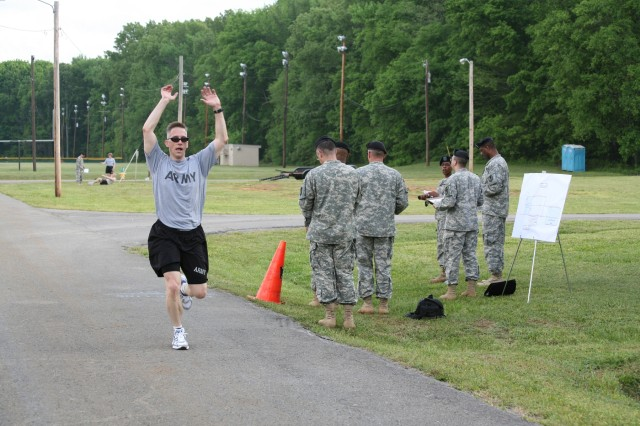 Lt. Col. Edward Pfeffer finishes the two-mile run with enthusiasm.