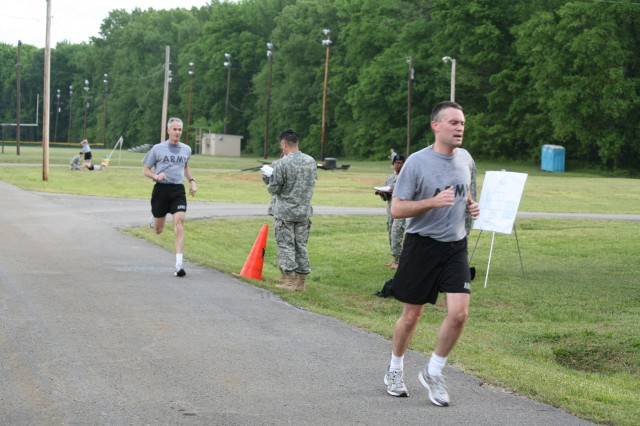 Maj. Stephen Murphy crosses the finish line followed closely by Lt. Gen. Keven T. Campbell.