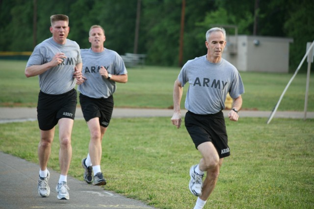 (From lead), Lt. Gen. Kevin T. Campbell, Maj. Brian Adams and Lt. Col. Joseph Gaines complete the first half of the two-mile run.