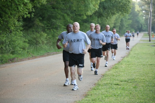 SMDC/ARSTRAT Soldiers complete the first of four laps during the two-mile run.