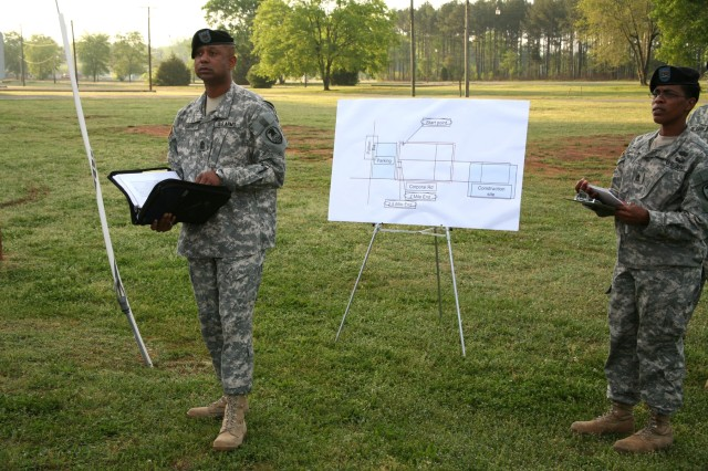 1st Sgt. Petey Smith prepares SMDC/ARSTRAT Soldiers for the two-mile run as Sgt. 1st Class Erika White assists.