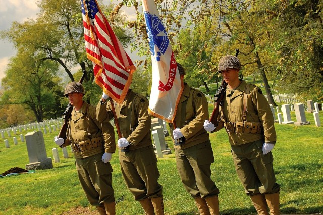 The Army Reserve color guard at Arlington National Cemetery wore wool uniforms of World War II to commemorate the component's history.