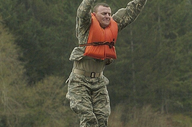 Sergeant Kevin Perkins from C Trp., 1-14 Cav. drops into Fort Lewis' Sequalitchew Lake.