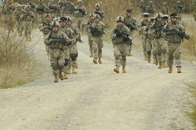 Soldiers from B Troop, 1-14 Cav. march toward Fort Lewis' Sequalitchew Lake after completing the confidence course.