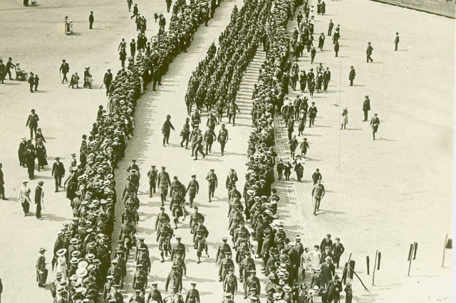 Teaser Image: Led by a British military band, these American troops were the vanguard of the American Expeditionary Force.  These first American Soldiers to reach London march through the city to the cheers of English spectators (World War I Signal Corps Collection).""