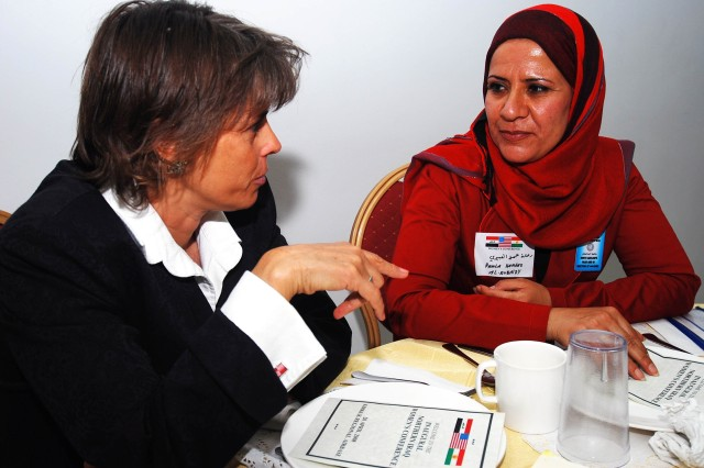 Melissa J. Ward, Kirkuk Provincial Reconstruction Team's Governance Advisor, and Ramla Hameed Obedi, Kirkuk Provincial Council member, discuss issues effecting women in the province at the Inaugural Northern Iraq Women's Conference held at Forward Operating Base Warrior, Kirkuk, Iraq, April 20.