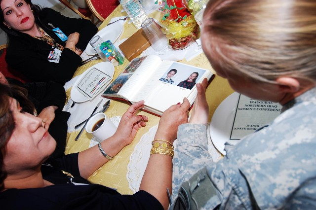 The dialogue remained light with more interest in getting to know one another as Soldiers and Airmen brought photo albums, sharing pictures of family and friends with attendees, who in turn, shared theirs at the Inaugural Northern Iraq Women's Conference held April 20 at FOB Warrior, Kirkuk, Iraq.