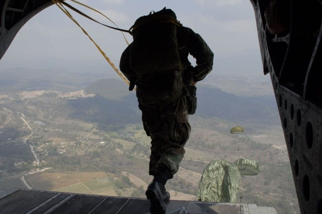A paratrooper leaps from the back of a Joint Task Force-Bravo CH-47 Chinook helicopter over the Tamara Drop Zone, the site of this year's Iguana Voladora 2008. The airborne exercise is Joint Task Force-Bravo's largest joint and combined training event developed to strengthen regional cooperation and security between countries of the Americas.