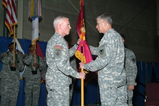 Brig. Gen. Scott West (left) is handed the TACOM Life Cycle Management Command colors by Army Materiel Command Gen. Benjamin Griffin signifying the transfer of leadership responsibility.