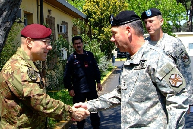 Col. Raffaele Iubini, left, Italian base commander at Camp Darby, greets Lt. Gen. Robert Wilson, commander of Installation Management Command, during Wilson's visit April 29.