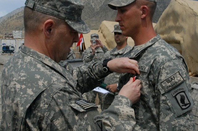 "Brig. Gen. Mark Milley, CJTF-101 deputy commanding general of operations, awards the Bronze Star with ""V"" device for valor to Army Sgt. Ryan P. Inabnet, 173rd Airborne Brigade Combat Team, 1-91 Cavalry Squadron."