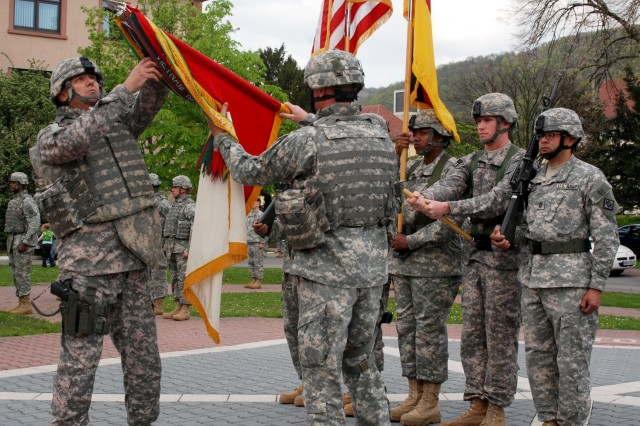 Col. Matthew Russell, 18th Engineer Brigade commander, prepares to case the brigade's colors, signifying the start of the unit's deployment to Iraq, in a ceremony on Campbell Barracks in Heidelberg, Germany, April 24. During the deployment, 'TF Sapper' will manage the brigade's operations in the rear and care for the Family members and non-deploying Soldiers of the 18th.