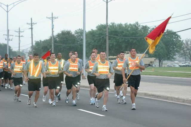 """Col. Paul E. Funk II (third from right), the 1st Brigade Combat Team, 1st Cavalry Division commander and a native of Roundup, Mont., leads the """"Ironhorse"""" Brigade, in a brigade run on April 22 at Fort Hood, Texas.  The run marked the last time Funk would run with his troopers and took place prior to his April 25 change of command."""
