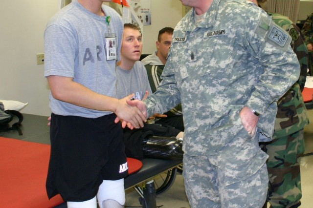 Stg. Maj. of the Army Kenneth O. Preston visits with Sgt. Chang Wong at the amputee care center in 2006.