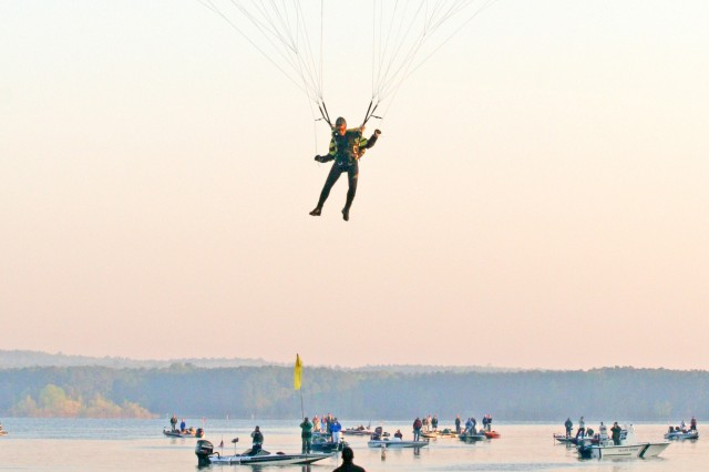 """SFC Elisa Tennyson, a parachutist with the Army's Golden Knights demonstration team, approaches her landing target during the opening ceremonies of the third annual """"Warriors on the Water"""" bass tournament April 18 at Jordan Lake, N.C."""
