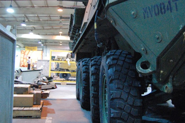 A Stryker Combat Vehicle awaits the next stage of work at the 1st Battalion, 401st Army Field Support Brigade Stryker Battle Damage Repair Facility at Camp As Sayliyah, Qatar