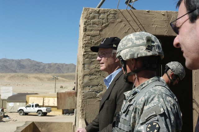 Secretary of the Army, the Honorable Pete Geren observes a cordon and search operation during a visit to the National Training Center and Fort Irwin, CA.