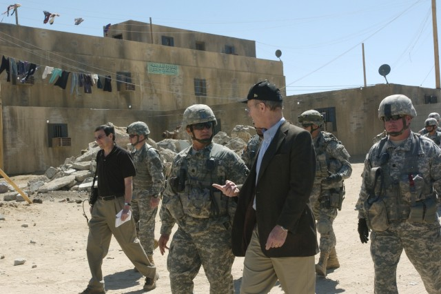 Lieutenant Colonel Ronald Metternich, Operations Group, the National Training Center and Fort Irwin, briefs Secretary of the Army, the Honorable Pete Geren in the mock village of Medina Jabal at the NTC.