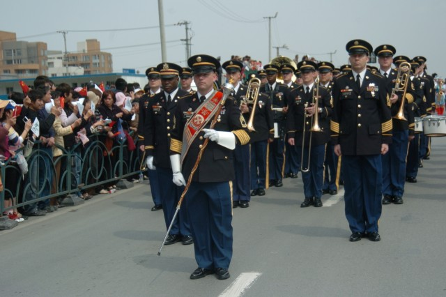 The Eighth United States Army Band performs during a parade for the opening ceremony of the 2008 Shanghai Spring International Music Festival in Shanghai, China April 30.  The band will also perform at a concert held at Zhengda Indoor Stadium at Fudan University, Shanghai.