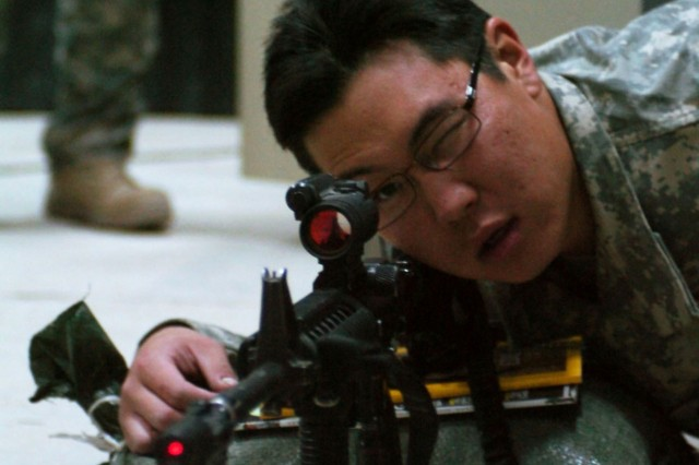 Spc. Peter Lee, gunner, Task Force Dragon, uses the bore light targeting system to accurately sight in his weapon system. The bore light system gives Soldiers a good zero without having to go to the range.