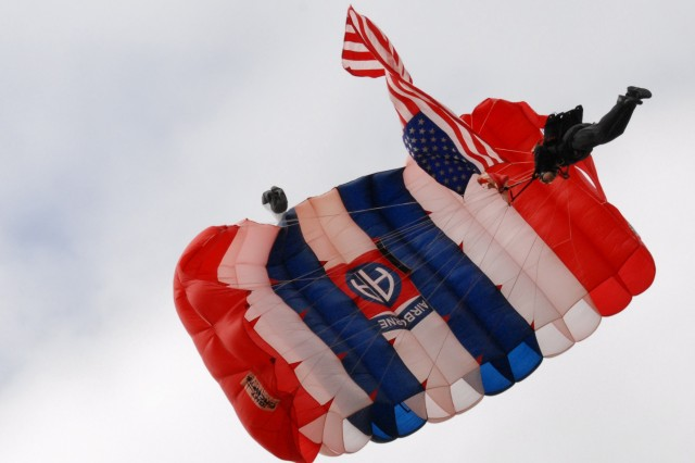 Staff Sgt. Jake Conrad of the 82nd Airborne DivisionAca,!a,,cs All-American Freefall Team performs a precision jump with the American flag onto a field behind the Port OAca,!a,,cConnor Community Center in Texas during WarriorAca,!a,,cs Weekend, May 3.