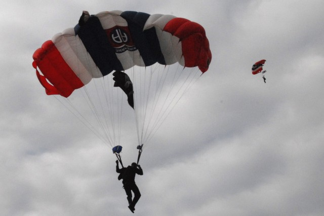 The 82nd Airborne Division All-American Freefall TeamAca,!a,,cs Sgt. Chris Clark (foreground) and Sgt. Josh Seal jump onto the field behind the Port OAca,!a,,cConnor Community Center during WarriorAca,!a,,cs Weekend in Texas, May 3.