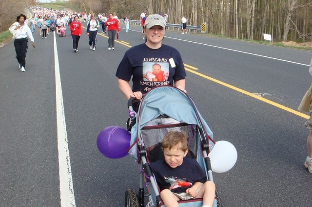 Staff Sgt. Wendy Spohn, clarinet player with the U.S. Army Materiel Command Band, walks in the 2007 March of Dimes walk in Abingdon, Md., with her son Lukas. (Courtesy Photo)