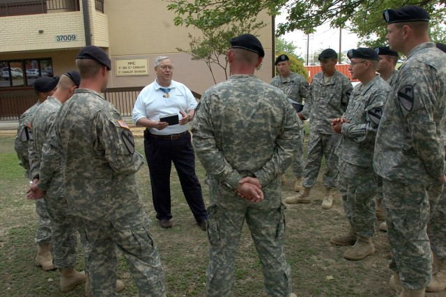 Medal of Honor recipient Charles Hagemeister talks to medics from his former unit, Headquarters and Headquarters Company, 1st Battalion, 5th Cavalry Regiment, 2nd Brigade Combat Team, 1st Cavalry Division, during his visit with the Black Jack troops May 1.