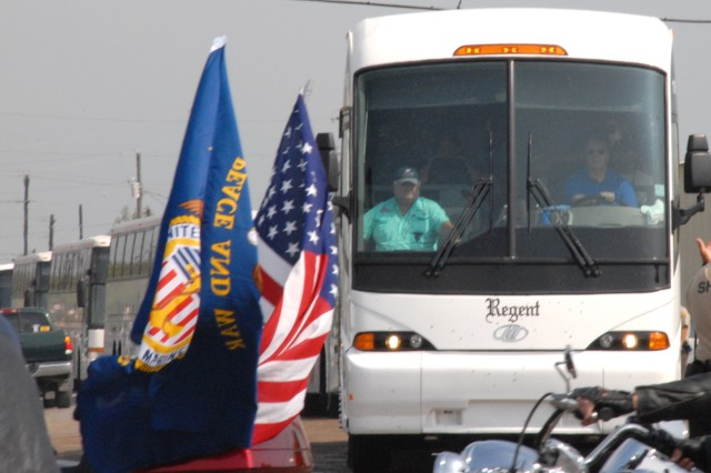 Six buses of wounded warriors from Brooke Army Medical Center in Fort Sam Houston, Texas, arrive at the pier in Port O'Connor, Texas to go fishing during Warrior's Weekend. Ron Kocian, the weekend organizer, is pictured to the left in the first