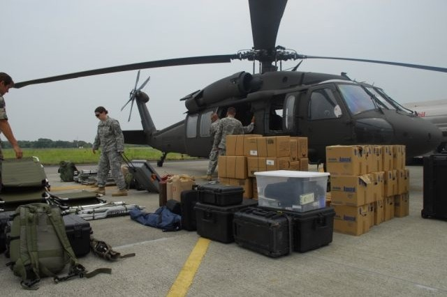 Members of Joint Task Force-Bravo unload a UH-60 helicopter at Comalapa Air Base, El Salvador May 4 in preparation for Fuerzas Aliadas Humanitarias 2008, the U.S. Southern Command and Salvadoran Ministry of Defense-sponsored disaster relief exercise.