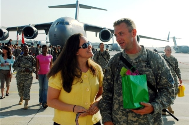 "Amanda Clarke and Army Capt. Gavin McCulley participate in the filming of Lifetime Network's ""Army Wives"" on Monday at Charleston Air Force Base, S.C."