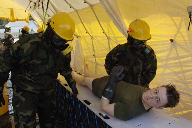 A simulated victim of a chemical attack is decontaminated by members of the Chemical Biological Incident Response Force during a National Level Exercise at Fort Lewis, Wash.  The Marine Corps response unit, from Indian Head, Md., is a one-of-a-kind initial response force.
