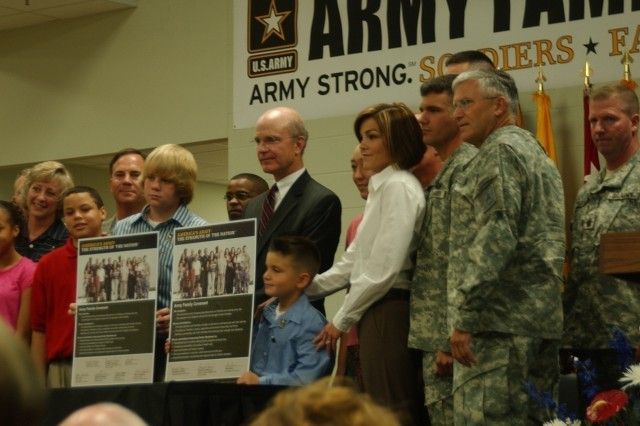 Secretary of the Army Pete Geren and Family members at Fort Knox, Ky., hold up the Army Family Covenant just after signing it Oct. 17. On the right is Sgt. Maj. of the Army Kenneth O. Preston and Chief of Staff of the Army Gen. George W. Casey Jr., who also signed the covenant.