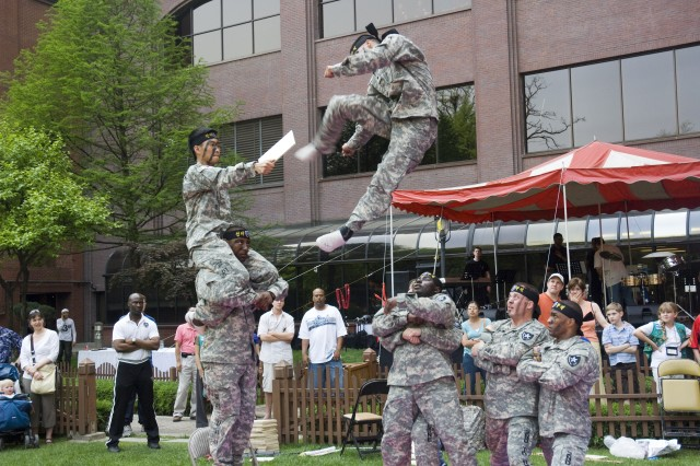 """YONGSAN GARRISON, Republic of Korea Aca,!"""" Members of the 2nd Infantry Division Tae Kwon Do Demonstration team perform at the Dragon Hill Lodge 18th Anniversary celebration May 3."""