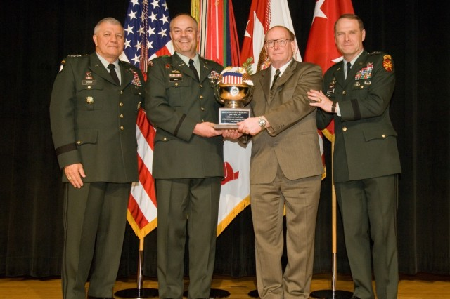 Army Vice Chief of Staff Gen. Richard A. Cody (left) and Installation Management Command Deputy Commander Maj. Gen. John A. Macdonald (right) present USAG-Yongsan officials with a third place trophy for the Fiscal 2008 Army Communities of Excellence competition May 8 at the Pentagon. Garrison Commander Col. Dave Hall and Plans, Analysis and Integration Chief Barry Robinson represented the Yongsan community.