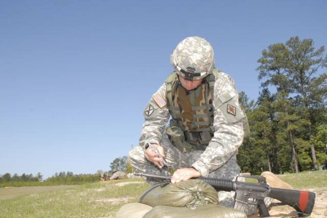 Staff Sgt. Herbert Thompson, Drill Sergeant School, adjusts his weapon April 28 at Range 10 before the rifle marksmanship portion of the 2008 Fort Jackson Drill Sergeant of the Year Competition.
