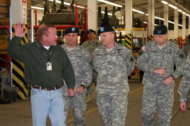 Bill Gordon leads Col. Al Evans, director of the TASM-E, Maj. Gen. Yves Fontaine and Brig. Gen. Jon Miller through some of the TASM-E\'s facilities on Coleman Barracks.